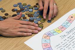 Board game to help school children develop numeracy skills,