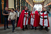 Three medieval knights spend lunchtime on St Georges Day in Leadenhall Market in the capitals financial district aka The Square Mile, on 23rd April, City of London, England.