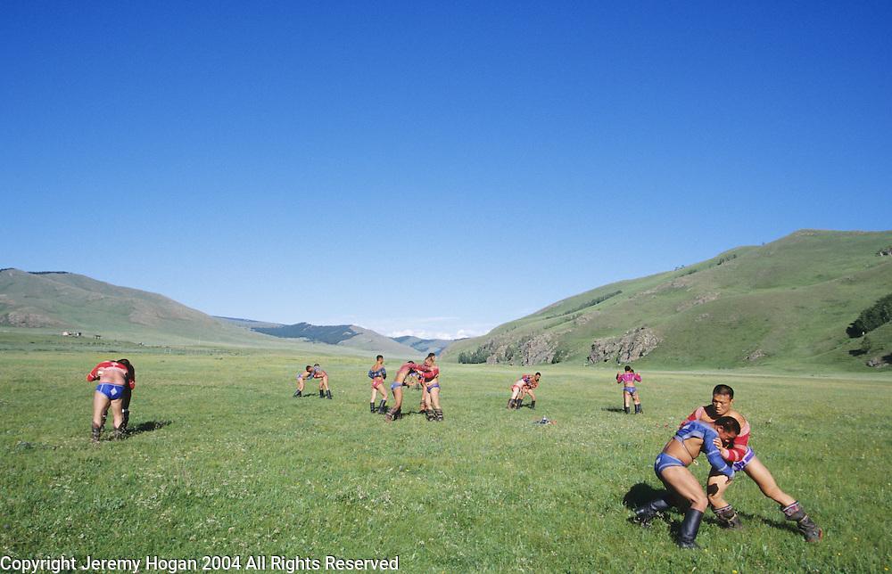 Mongolian wrestlers practice at a secrect wresting training camp outside Ulaanbaatar, Mongolia.