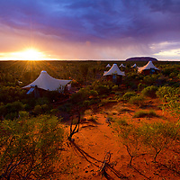 Sunrise over Uluru and luxury resort, Longitude 131, NT.