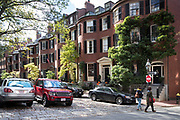 Land Rover car and locals in Lonsburg Square in the Beacon Hill historic district of Boston, Massachusetts, USA