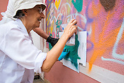 08/09/2015 - Lisbon, Portugal: Luisa Cortesão, 65, a retired doctor, using a stencil to paint the wall during a Lata 65 workshop. Luisa was one of the first participants of the project Lata 65. Today she helps organizing other workshops and in her spare time she graffitis some walls with her grandaughters. Lata 65 was project created by Lara Seixo Rodrigues and is a creative workshop teaching street art to senior citizens. (Eduardo Leal)