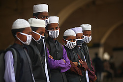 March 18, 2020, Dhaka, Bangladesh: Bangladeshi madrasa students wear face masks to protect against the spread of the Coronavirus during leaving the Dhaka. More than 19.5 million people live in Dhaka, the most densely populated city in the world with more than 23,234 people per square kilometer, to avoid higher chances of contracting the infectious and deadly COVID-19. (Credit Image: © Mehedi Hasan/NurPhoto via ZUMA Press)