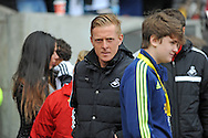 Swansea city Manager Garry Monk takes his place in the dugout ahead of kick off.<br /> Barclays Premier league match, Swansea city v Southampton at the Liberty stadium in Swansea, South Wales on Saturday 3rd May 2014.<br /> pic by Phil Rees, Andrew Orchard sports photography.