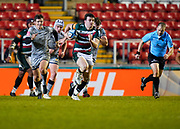 Leicester Tigers centre Matt Scott collects the ball as Sale Sharks fly-half AJ McGinty gives pursuit during a Gallagher Premiership Round 7 Rugby Union match, Friday, Jan. 29, 2021, in Leicester, United Kingdom. (Steve Flynn/Image of Sport)