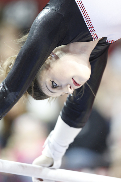 Madison McConkey competes on the uneven bars against Minnesota at the Bob Devaney Sports Center in Lincoln, Neb., on Feb. 12, 2016. Photo by Aaron Babcock, Hail Varsity
