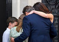 © Licensed to London News Pictures. 13/07/2016. London, SAMANTHA and DAVID CAMERON hug their children ARTHUR, FLORENCE and NANCY on the doorstep of Number 10 Downing Street as they leave for the last time before Theresa May is sworn in this evening. Photo credit: Ben Cawthra/LNP