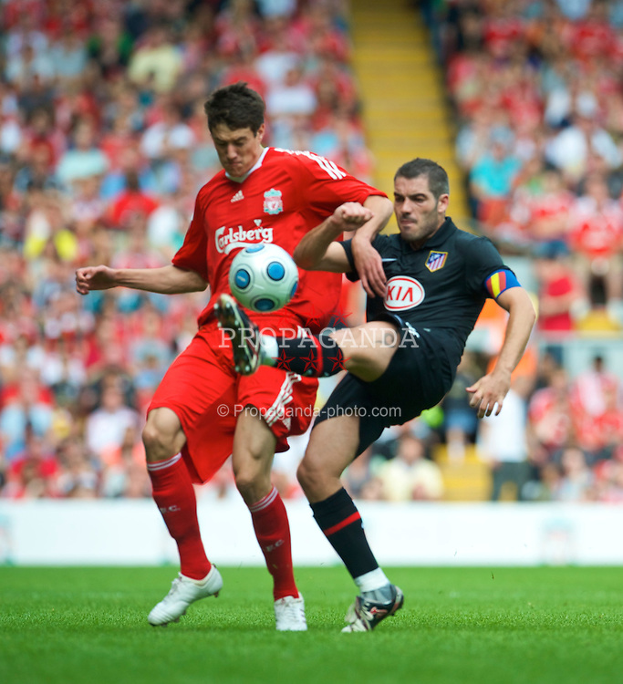 LIVERPOOL, ENGLAND - Saturday, August 8, 2009: Liverpool's Martin Kelly and Club Atletico de Madrid's captain Antonio Lopez during the pre-season friendly match at Anfield. (Pic by: David Rawcliffe/Propaganda)
