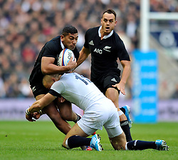 Julian Savea (New Zealand) is tackled by Mike Brown (England) - Photo mandatory by-line: Patrick Khachfe/JMP - Tel: Mobile: 07966 386802 16/11/2013 - SPORT - RUGBY UNION -  Twickenham Stadium, London - England v New Zealand - QBE Autumn Internationals.