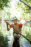 Boy on Canoe, Mclaren Harbour, Tufi, Cape Nelson, Oro Province, Papua New Guinea