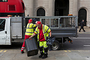 Workers with City of London street contractor Amey, load plastic bags of litter and waste into their van outside the Bank of England, on 3rd September 2018, in London England. Amey PLC provides street cleansing and waste collection services on behalf of the City of London Corporation, along with bespoke total waste management solutions to businesses in and around the City of London. Amey's workforce of 19,000 works across four continents – making us a leading supplier of consulting and infrastructure support services both in the UK and internationally.