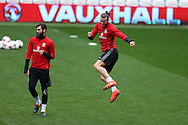 Gareth Bale of Wales ® jokes around with Joe Ledley of Wales (l)  during the Wales football team training at the Cardiff city Stadium in Cardiff , South Wales on Saturday 8th October 2016, the team are preparing for their FIFA World Cup qualifier home to Georgia tomorrow. pic by Andrew Orchard, Andrew Orchard sports photography