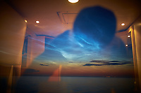 Reflection of a Noctilucent Creature Invading My Cabin on the MV Explorer -- Gulf of Finland. Image taken with a Fuji XT1 camera and 23 mm f/1.4 lens (ISO 200, 23 mm, f/1.4, 1 sec).