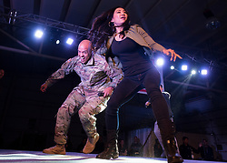 December 21, 2017 - Sevilla, Spain - Wrestler Gail Kim throws Army Sergeant First Class Cam Mitchell offstage during Chairman?'s USO Holiday Tour at Moon Air Base Dec. 21, 2017. Marine Corps Gen. Joe Dunford, chairman of the Joint Chiefs of Staff, and Command Sgt. Maj. John W. Troxell, senior enlisted advisor to the chairman of the Joint Chiefs of Staff, along with USO entertainers, visited service members who are deployed from home during the holidays at various locations across Europe and the Middle East. .(Credit Image: ? US Navy/ZUMA Wire/ZUMAPRESS.com)