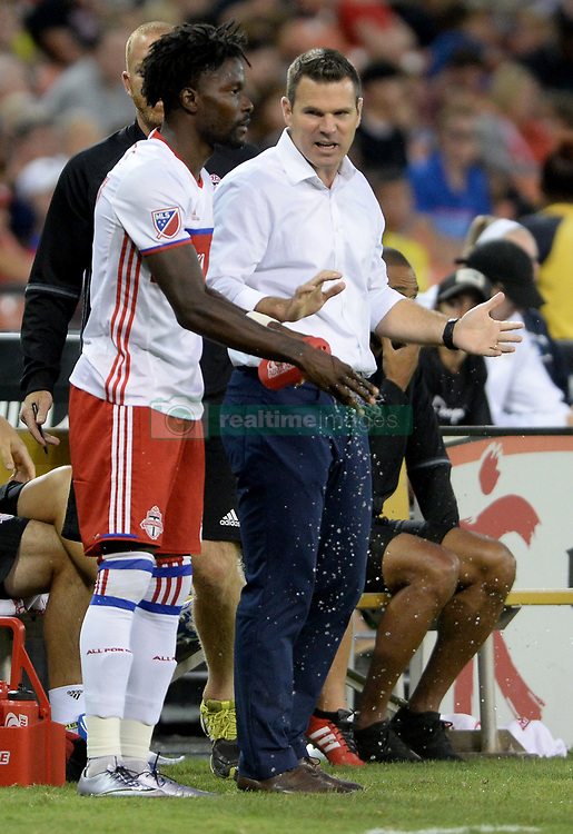 August 5, 2017 - Washington, DC, USA - 20170805 - Toronto FC coach GREG VANNEY speaks with Toronto FC forward TOSIANT RICKETTS (87), before Ricketts enters the match against D.C. United in the second half at RFK Stadium in Washington. (Credit Image: © Chuck Myers via ZUMA Wire)