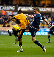 Photo: Ed Godden.<br />Wolverhampton Wanderers v Southend United. Coca Cola Championship. 04/11/2006. Wolves' Rohan Ricketts (L) is tackled by Simon Francis.