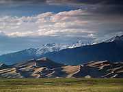 The Great Sand Dunes National Park and Preserve -- located in the San Luis Valley of Colorado -- with the Sangre de Cristo Mountains in the distance, including Crestone Peak and Crestone Needle (both exceed 14,000 feet).