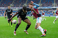Barnsley defender Dimitri Cavare  (12) battles with Burnley midfielder Jeff Hendrick (13) during the The FA Cup 3rd round match between Burnley and Barnsley at Turf Moor, Burnley, England on 5 January 2019.
