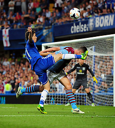 "Chelsea's Oscar catches Aston Villa's Ciaran Clark with a high boot  - Photo mandatory by-line: Joe Meredith/JMP - Tel: Mobile: 07966 386802 21/08/2013 - SPORT - FOOTBALL - Stamford Bridge - London - Chelsea V Aston Villa - Barclays Premier League - EDITORIAL USE ONLY. No use with unauthorised audio, video, data, fixture lists, club/league logos or ""live"" services. Online in-match use limited to 45 images, no video emulation. No use in betting, games or single club/league/player publications"