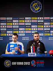 Luka Zvizej of Slovenia and Boris Denic, head coach of Slovenia during press conference after the handball match between Norway and Slovenia in Preliminary Round of 10th EHF European Handball Championship Serbia 2012, on January 16, 2012 in Millennium Center, Vrsac, Serbia. Norway defeated Slovenia 29-28. (Photo By Vid Ponikvar / Sportida.com)