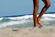Naked man walking in Levante beach - Playa de Llevant -, Formentera