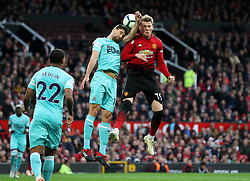 Manchester United's Scott McTominay (right) and Newcastle United's Federico Fernandez battle for the ball during the Premier League match at Old Trafford, Manchester.