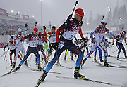 Competitors including Anton Shipulin (13) of Russian take off for the men's 15K mass start biathlon at the Laura Cross-Country Ski and Biathlon Center at the Winter Olympics in Sochi, Russia, Tuesday, Feb. 18, 2014. (Brian Cassella/Chicago Tribune/MCT)