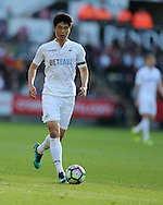 Ki Sung-Yueng of Swansea city in action .Premier league match, Swansea city v Watford at the Liberty Stadium in Swansea, South Wales on Saturday 22nd October 2016.<br /> pic by  Andrew Orchard, Andrew Orchard sports photography.