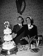 11/02/1953<br /> 02/11/1953<br /> 11 February 1953<br /> Wedding of Mr. J. Burke, 22, Shelton Drive, Kimmage Road West and Miss Maura O'Brien, 9, Tyrconnell Street Inchicore, at St. Michael's Church Inchicore. With the cake at the reception at Barry's Hotel, Dublin.