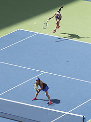 NEW YORK, Sept. 11, 2017  Yung-Jan Chan (Top) of Chinese Taipei and Martina Hingis of Switzerland compete during the women's doubles final match against Lucie Hradecka and Katerina Siniakova of the Czech Republic at the 2017 US Open in New York, the United States, Sept. 10, 2017. Yung-Jan Chan and Martina Hingis won 2-0 to claim the title. (Credit Image: © Wang Ying/Xinhua via ZUMA Wire)