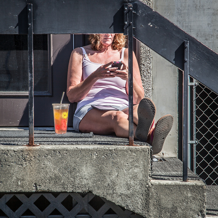Cindy Burrill enjoys a few minutes of sun in downtown Anchorage  clbunak@gmail.com