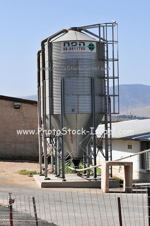 Israel, Galilee, a chicken coop with feeding silo on a Kibbutz