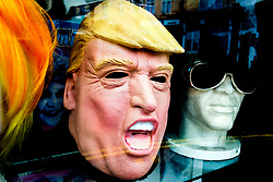 Terrifying Donald John Trump, who before becoming 45th  President of the United States was a businessman and television personality, latex facemask in display in shop window<br /> <br />   02 September 2017 <br />   Copyright Paul David Drabble<br />   www.pauldaviddrabble.co.uk