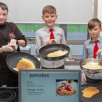 Eoin Costelloe, Robert Loftus and Frankie Toner making pancakes for the Jessies Fruity Express showcase day at Ennis National school