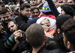 April 26, 2018 - Gaza City, The Gaza Strip, Palestine - Palestinian mourners carry the body of Palestinian journalist Ahmed Abu Hussein, while who was shot two weeks before by Israeli forces while covering demonstrations on the Gaza border, during his funeral in Jabalia in the northern Gaza Strip on April 26, 2018, after he succumbed to his injuries. (Credit Image: © Mahmoud Issa/Quds Net News via ZUMA Wire)