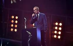 Zane Lowe on stage at the Brit Awards at the O2 Arena, London.