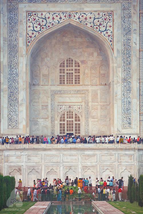 Tourists wait in line to enter the Taj Mahal mausoleum, Agra, Uttar Pradesh, India.
