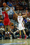 Aaron Harrison (2) of Fort Bend Travis shoots over Trey Hall (4) of South Grand Prairie during the UIL 5A state championship game at the Frank Erwin Center in Austin on Saturday, March 9, 2013. (Cooper Neill/The Dallas Morning News)