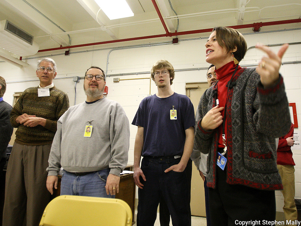 University of Iowa music professor Mary Cohen (right) teaches a new song to the the Oakdale Prison Community Choir at the Iowa Medical and Classification Center in Coralville on Tuesday March 3, 2009.