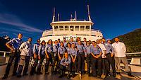 "Crew of the Un-Cruise small cruise ship ""Wilderness Explorer"" in Nakwasina Sound,  Inside Passage, Southeast Alaska USA."