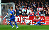 Jean-Louis Akpa Akpro scores with a deflected shot to give Shrewsbury the lead during the Sky Bet League 2 match between Cheltenham Town and Shrewsbury Town at Whaddon Road, Cheltenham, England on 25 April 2015. Photo by Alan Franklin.