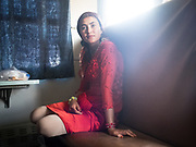 """Aïgul travels with her mother back to Yarkand, after visiting relatives in Hotan. She carried a lunch of bread called """"non"""" inside a plastic bag. Life inside the train - mostly Muslim Uighur people  ride this train."""