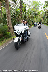 Klock Werks' Brian Klock and Venessa Nay riding one of the limited edition Jack Daniel's Indian Chieftain motorcycles that Brian designed through Tamoka State Park during Daytona Beach Bike Week. FL. USA. Monday March 13, 2017. Photography ©2017 Michael Lichter.