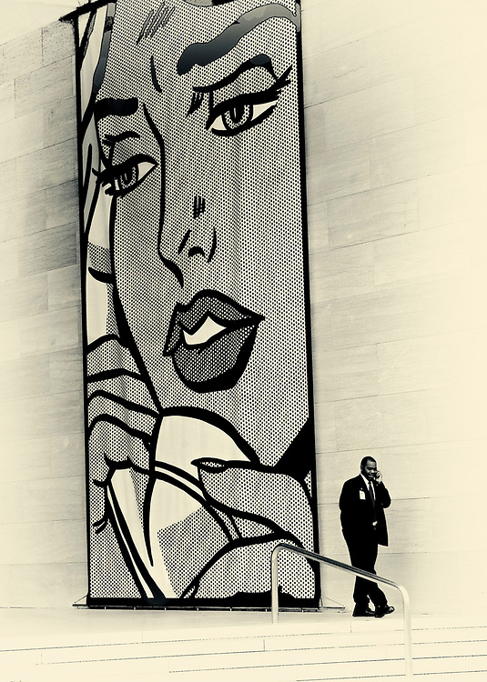 The Museum of Modern Art in Washington DC was sponsoring an exhibition by Roy Lichtenstein.  This image of a docent making a phone call on the steps of the museum was the product of observation and lucky timing.