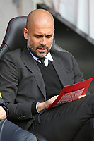 Football - 2016 / 2017 Premier League - Southampton vs. Manchester City<br /> <br /> Manchester City Manager Pep Guardiola checks over a team sheet before kick off at St Mary's Stadium Southampton<br /> <br /> COLORSPORT/SHAUN BOGGUST
