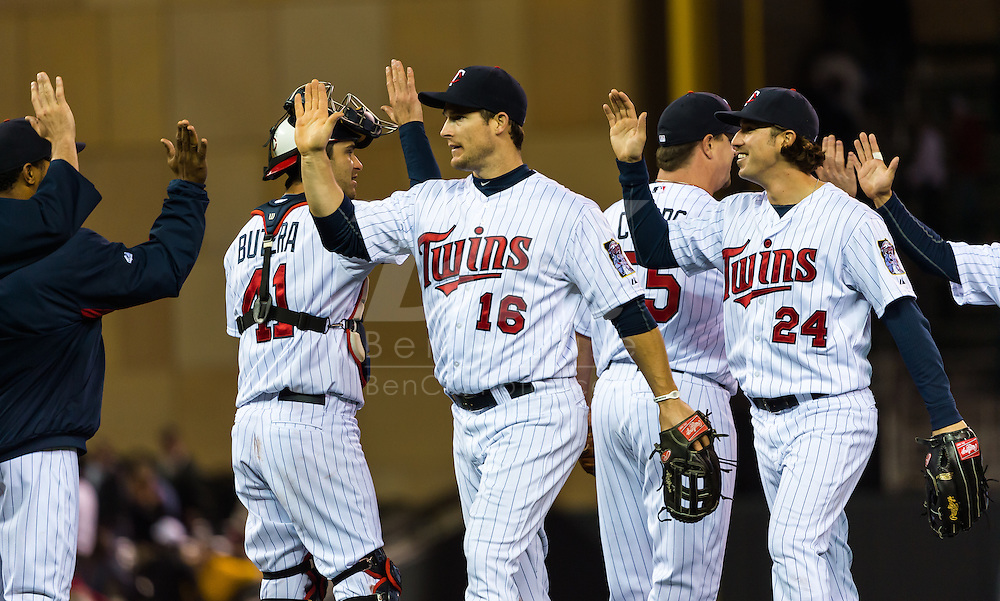 Minnesota Twins Trevor Plouffe, Drew Butera, Matt Capps, and Josh Willingham celebrate the team's victory against the Los Angeles Angels on May 8, 2012 at Target Field in Minneapolis, Minnesota.  The Twins defeated the Angels 5 to 0. © 2012 Ben Krause