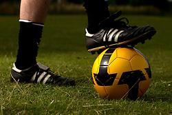 A man controls a football