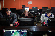 Chinese men of all ages surf the internet in a cyber-cafe in Hangzhou, China.