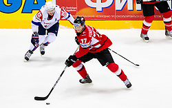 Marcel Rodman of Slovenia vs Thomas Hundertpfund of Austria during ice-hockey match between Austria and Slovenia of Group G in Relegation Round of IIHF 2011 World Championship Slovakia, on May 7, 2011 in Orange Arena, Bratislava, Slovakia. (Photo By Vid Ponikvar / Sportida.com)