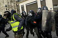 Police charging protesters. More than 125000 gathered in Paris for the Gilets Jaune (Yellow vest) protest. Soon the protest turned violent an protesters clashed with the police, tear gas and flash bombs were fired, many injured and arrested by the police. Paris December 6th 2018. Federico Scoppa